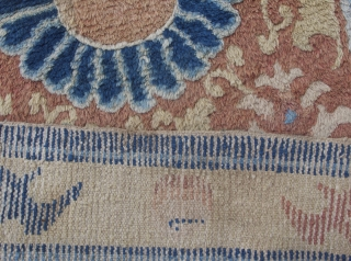 Antique Ningxia runner with yin-yang medallion and fo-dogs. Part of a long temple runner, hence bothe ends replaced. 19th century. 170x70cm.