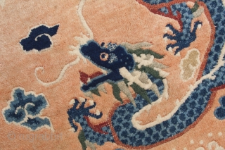 Elegant Chinese 5 dragon rug. 5-clawed dragons and wave and cloud border. Good condition, see images. Circa 1920. 215x128cm.