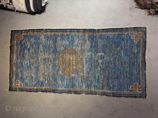 Chinese or Tibetan, cm 143x67. low pile with a big portion resotred. Anyway lovely piece.