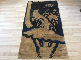 beautiful antique  Chinese rug wits very nice bird seating on the tree, the wood is like silk. The carpets has some repairs but still incredibly beautiful size 169x88 cm