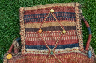 Primeval antique Luri (?) namakdan. 1 ft. 10 in. x 1 ft. 2 in. Wool. Earthy natural colors. Decorated with glass and stone beads. Very rare. unique in my experience. Nearly perfect  ...