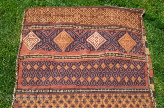 "Baluch kilim flatwoven khorjin. 5'5""X2'7"". First part 20th C or earlier. Wool. Natural dyes. Few signs of use/small patches on striped back. Light cheery palette is unusual. Washed by me."