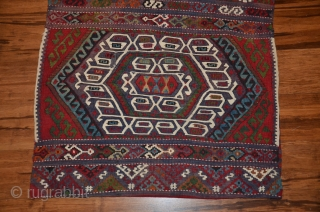 "Malataya kilim heybe 56""X27"". Early 20th.C. Wool and cotton (white designs). Intensely saturated and beautiful natural dyes. Plainwoven striped back. Open along sides. Excellent condition."