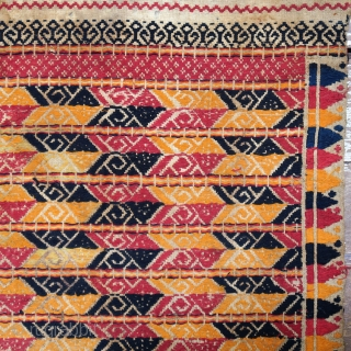 Indonesia   Antique ceremonial weaving tampan   Indonesia, Sumatra, Lampung, c. 1900   Handspun cotton base, supplementary weft weaving, botanical dyes, gold-wrapped thread    A large, festive tampan with a colourful geometric design of  ...