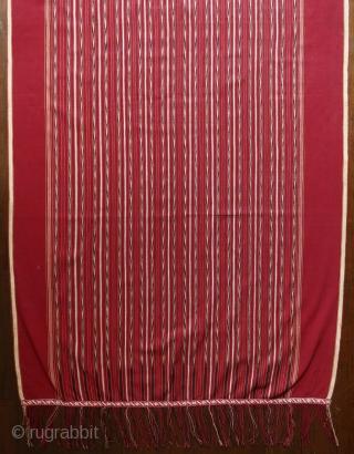 Sumatra | early 20th C Batak ceremonial textile Ulos Mangiring   Sumatra, Batak people, Toba, Silindung; c. 1930  Commercial cotton, natural and commercial dyes, warp ikat, continuous supplementary warp weaving  A single dark rose red  ...