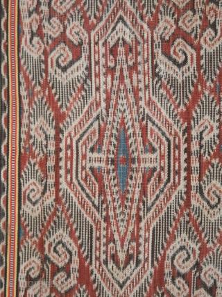 Borneo | early 20th C ikat Iban skirt (kain kebat or bidang)  Borneo, Sarawak, 1920 - 1940  Commercial cotton, warp ikat, alternating warp-faced float weave, natural dyes  A large Iban woman's skirt, woven in deep  ...