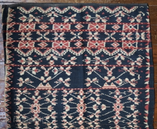"Indonesia   Early 20th C ikat tubeskirt  Pou dula nggeo no dula penis (tubeskirt with ""black"" And ""cross"" motifs)  Indonesia, Rote island, 1920s  Handspun cotton, natural dyes, warp ikat  An early tubeskirt (pou) woven on the  ..."