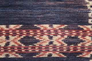 Ikat coffin cover or skirt   Origin: Roti island, Indonesia, c. 1900   Technique: Handspun cotton, natural dyes, warp ikat   Notes: This piece consists of two panels joined together along the selvedge. It was  ...