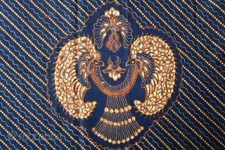 Batik skirt cloth (kain panjang)   Origin: Indonesia, Java, Solo, 2nd quarter of 20th century   Technique: Hand drawn batik, natural dyes   Notes: A traditional central Javanese batik design contrasting a large, repeating motif  ...