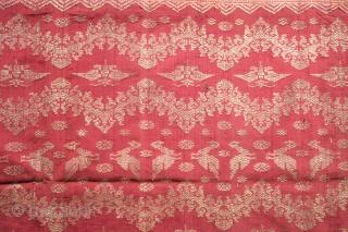 Balinese Silk Songket Hip Wrapper (Kamben)  Origin: Indonesia, Bali, Singaraja, 1900 -1920  Technique: Silk, silver-wrapped thread, supplementary weft weaving  Description: An elegant rose silk women's hip wrapper (kamben), woven in the principality of Singaraja in  ...