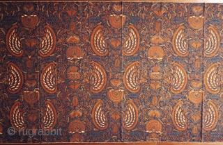 Batik skirt cloth (kain panjang)  Origin: Indonesia, Java, Yogyakarta, c. 1950  Technique: Hand-drawn (tulis) batik, natural indigo and soga dyes  Description: A densely drawn, semi-abstract design belonging to the most complex group of semen (from  ...