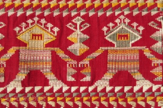 Borneo ceremonial carry-cloth (pua belantan)  Malaysia, Sarawak, Saribas region, 1950 or earlier  Cotton, silk, supplementary weft wrapping (sungkit)  A long solid red centrefield decorated at the ends in detailed silk sungkit, depicting two rows of  ...