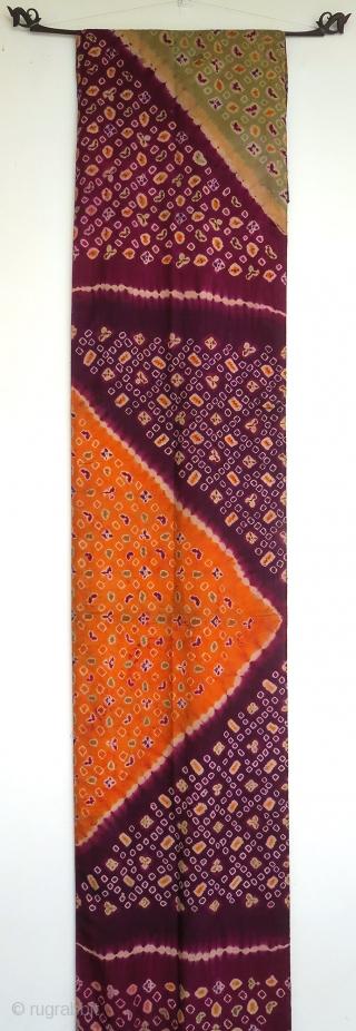 Bali   Tie-dye pelangi silk wrapper, early 20th century  Indonesia, Bali, Singaraja, early 20th century  Imported silk, aniline dyes, tie-dye (pelangi) and stitch-resist (tritik)  A stunning silk pelangi wrapper tie-dyed in Singaraja in north Bali.  ...
