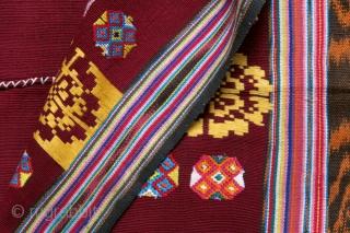 Timor Leste | Vintage festive tubeskirt lau o'o mimireke ('red mouth cloth')  Timor Leste, Baucau or West Lautem, 1970s  Warp ikat, supplementary warp weave, discontinuous supplementary weft  A festive red tubeskirt (lau o'o mimireke) woven  ...