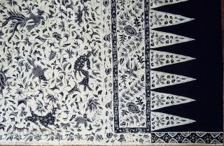 Javanese batik hipcloth (Kain Panjang)  Origin: Java, Cirebon, c. 1930  Technique: Commercial cotton, natural dyes, hand-drawn (tulis) batik  Description:  A very charming blue and white batik hipcloth hand-drawn in the court town of Cirebon  ...