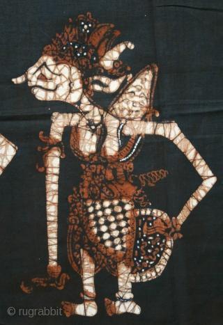 Javanese Batik Wall Hanging with Wayang Figures   Origin: Indonesia, Java, Jogjakarta, 1940 – 1960  Technique: Commercial cotton, mixed dyes, hand-drawn (tulis) batik  Description: A dramatic batik hanging from Jogjakarta, hand-drawn with wayang kulit (shadow  ...