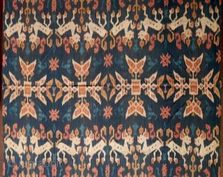 Sumba | Ikat Men's Mantle with red dye (Hinggi Kombu)   Indonesia, East Sumba, Rende, before 1970  Handspun cotton, natural dyes, warp ikat, surface painting, twining  A gorgeous men's mantle (hinggi) from Rende in east  ...
