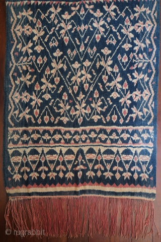 Indonesia | Early 20th C ikat shoulder cloth (lafa)  Indonesia, Rote, 1900-1920  Handspun cotton, botanical indigo and morinda dyes, warp ikat  A fine antique ikat shoulder cloth made up of two panels, stitched together along  ...