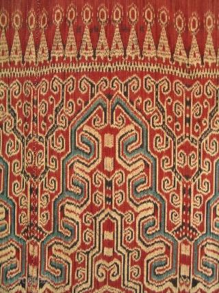 KALIMANTAN PUA  Type: Ikat Ritual Cloth (Pua)    Origin: Indonesia, Kalimantan, Saribas border, 1920 - 1940s  Technique: Commercial cotton, natural dyes, warp ikat  Description: A very fine, ikat ritual / ceremonial hanging (pua) woven by  ...