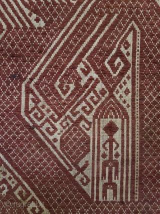 Indonesia | Antique ceremonial weaving tampan   Indonesia, Sumatra, Lampung, Komering, Paminggir people, c. 1900   Handspun cotton base, supplementary weft weaving, botanical dyes    A large tampan with an imposing design executed in  ...