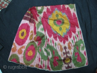 A matching pair of  Antique Uzbek silk Ikat craddle covers. Very good condition. Both pieces have a hole for the stick.
