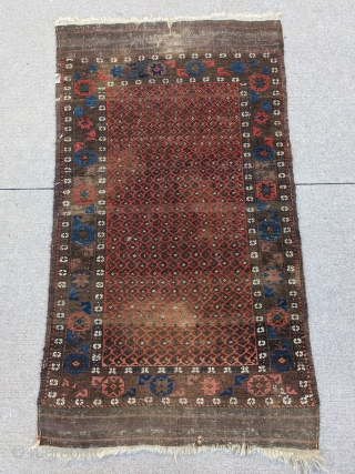 Fun little old Baluch. Great for use as a scatter rug or any space. Love that glowing red field to outline the botehs.   5ft6in x 3ft1in or 168 x 94cm  Low pile, one  ...