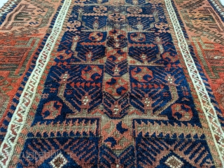 Stunning antique Baluch. 5ft 6in x 3ft 1in. Real unique center panel design. High soft wool except the corroded brown areas. Great colors.  Cheers.