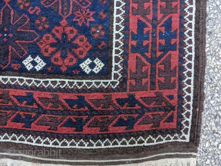 """Antique snowflake Baluch rug. 3'4"""" x 6'5"""". Perfect condition as it was hung on the wall. Original goat hair selvedge and kilim ends. Soft, thick, fluffy wool."""