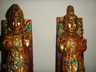 "Rare, Antique 19thCentury Burmese Male & Female Guardian Spirit (""Nat"") wooden satuettes. Lacquered, Gold-gilt with coloured mirror-glass inlay. Made as handles for a Prayer chamber door and/or cupboard for storing religious articles.  ..."