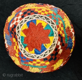 A fully embroidered hat from Central Asia. They are composed of silk embroidery on cotton and linen