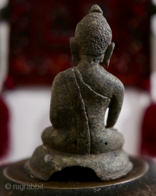 "Antique bronze miniature Burmese Buddha sitting in Bhumisparsha mudra posture.  Extremely old - 16th c?  older?.  Most likely excavated from beneath a stupa in old Burma.  3 1/2""H"