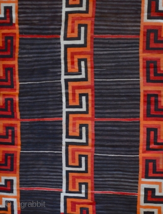 """A gorgeous Navajo Transitional blanket (1880-1910) tightly woven in handspun native wool, in natural brown and ivory, indigo and aniline colors, with a variant Chief's design, c1880.  condition excellent  96"""" x 62"""""""