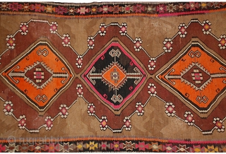 """An old Turkish flatweave,  11'2 x 5'7"""" hand-knotted wool tribal kilim in rich colors, some synthetic, with bold geometric pattern.  134"""" x 67"""""""