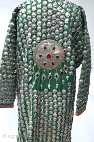 Turkestan Green Silver Medallions Wedding Coat covered front and back with hand stamped silver metal medallions and held together by silver carnelian pendants.
