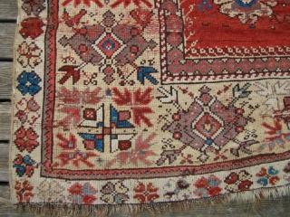 Turkish Milas Prayer Rug. Size: 46X65 inches 117X165 Cm. Has two hand size patches and the worn areas have backing glued to them so the foundation warps are still there.