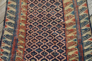 "An early unusual Soumak carpet, measures 6'6"" x 2'8"".  Very nice condition."