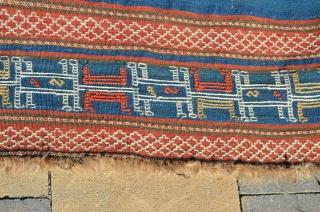 "Soumac brocading on plain weave ground.  Measures 6' x 3'3"""