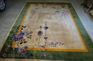 A very nice Nichols Art Deco Chinese rug circa 1920/1930.  Very pleasant neutral beige field.  Some corner damage, please see photos.  9'x12' Needs cleaning