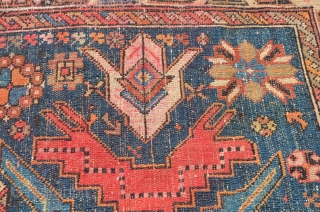 A very vibrant little Shirvan, early 20th century.  Wonderful colors, some minor restoration.  Metal hangers attached (sewn on) on the side, hangers also on one end.  Needs a cleaning.  ...