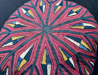 An exceptional antique Turkoman / Turkmen silk embroidered on silk bridal hat attributed to the Tekke / Teke tribe. Dating to the 19th century, this rare textile was an integral part of  ...