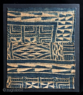 Indigo Blues.  Bamileke Ndop cloth fragment, Africa, Cameroon - 20th century.  This is a nice little resist dyed Ndop cloth fragment has charm.  It is mounted for display.   ...