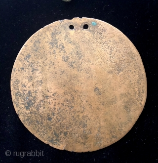 Collection of pre-conquest Andean bronze objects.  All date before c.1500.  Objects include a large circular disc shaped bronze pendant or shaman's mirror.  Various shaped pins for fastening textile garments.  ...