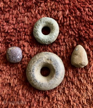 Ancient Andean stone implements.  A.D. 500- 1400's.  The stone discs (Andean Bagels) were used as mace heads or hammer stones when coupled with a wooden handle inserted through the center.  ...