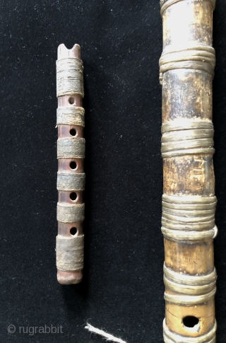 Andean Wind Instruments. For millennia Andean people have been playing wind instruments. Music was a vital part of Andean ritual and ceremony.  Seen here are two Pre-Columbian panpipes and two flutes  ...
