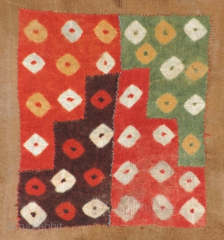Pre-columbian tie-dyed cloth panel. The original tie-dye!  Middle Horizon, Wari-related, Nasca area, South Coast of Peru. A.D. 500 - 800. This textile panel was once part of a large tunic or  ...