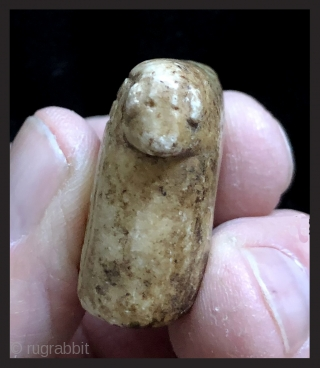 Carved and incised alabaster amulet.  19th century.  Bolivian Altiplano.  This type of fetish is called an illa (ee-ah). It was made in the shape of a generic domestic animal  ...
