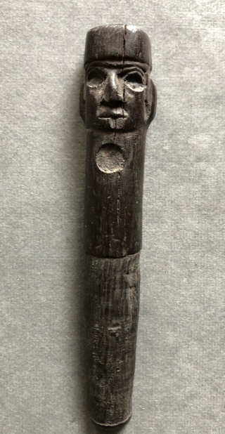 Carved Wari period figure with a four-cornered hat. This beautifully detailed, small Pre-Columbian wood carving was probably a stopper for some kind of container either wood, stone or ceramic.  Such a  ...