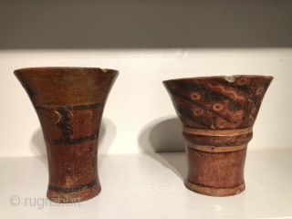 Group of six Tiwanaku period ceramic keros (drinking vessels).  A.D 400 - A.D. 1000.  Vessels such as these are rare.  They were used in ritual drinking bouts that were  ...