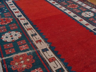 Such a beautiful rug. I believe it to be early nineteenth century. It has a fine weave with cotton wefts. 2.23m x 1.03m. Unrestored, some low areas and sides are missing. Now  ...