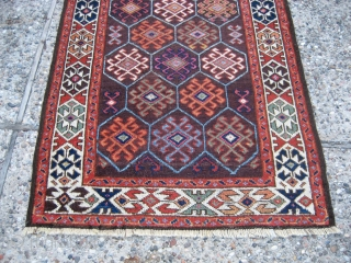 """Belouch 2' 11"""" x 5' 8"""".  Not sure how to identify this one.  It has elements of both Belouch and Kurdish (Quchan?) weaving.  Low-ish even pile, ends are intact, with one  ..."""